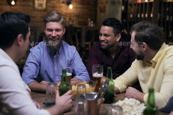 Good times with the best friends in the pub - Stock Photo - Images