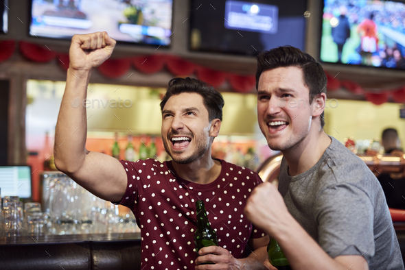 Grateful sports fans watching sports game - Stock Photo - Images