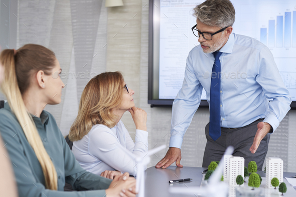 Business people having arguments with boss - Stock Photo - Images