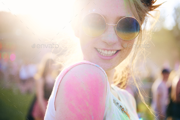 Happy woman in holi colors - Stock Photo - Images