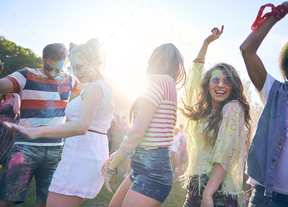 Friends during good party with multi colors - Stock Photo - Images