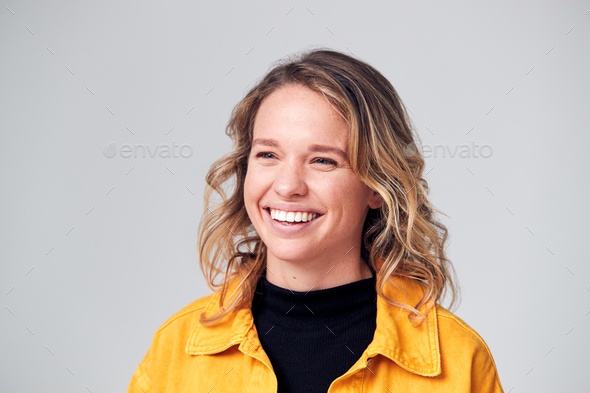 Studio Portrait Of Positive Happy Young Woman Smiling Off Camera - Stock Photo - Images