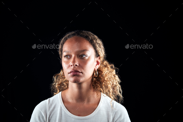 Head And Shoulders Studio Shot Of Unhappy Woman Looking At Camera With Sad Expression - Stock Photo - Images