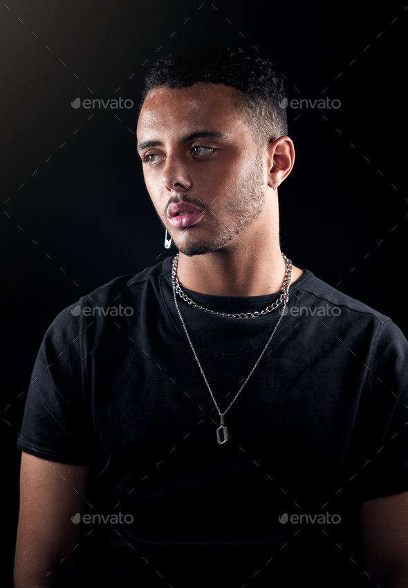 Studio Portrait Of Young Man With Skin Pigmentation Disorder Looking Off Camera - Stock Photo - Images
