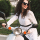 Pretty smiling stylish girl in white suite and sunglasses joyfully sitting on moped on street - PhotoDune Item for Sale