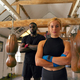 Portrait Of Male And Female Boxers In Gym Training Standing With Leather Punch Bags - PhotoDune Item for Sale