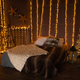 Cozy christmas bed with decor and lamps - PhotoDune Item for Sale