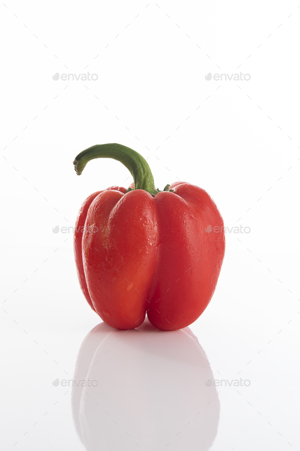 Red bell pepper on a white surface - Stock Photo - Images