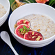 A bowl of porridge with figs slices and walnuts - PhotoDune Item for Sale