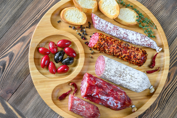 Assortment of salami with appetizers - Stock Photo - Images
