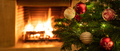 Christmas tree close up on burning fireplace background - PhotoDune Item for Sale