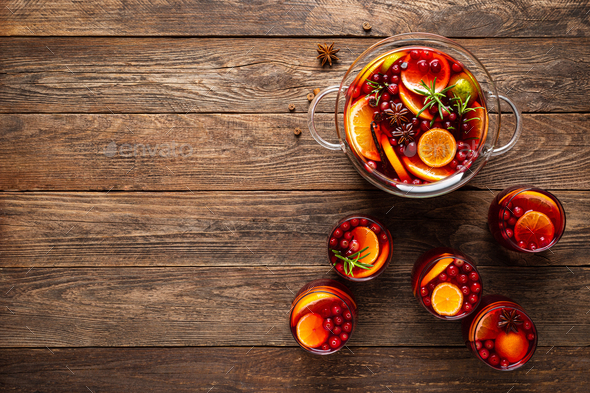 Christmas punch. Festive red cocktail, drink with cranberries and citrus fruits in a punch bowl - Stock Photo - Images