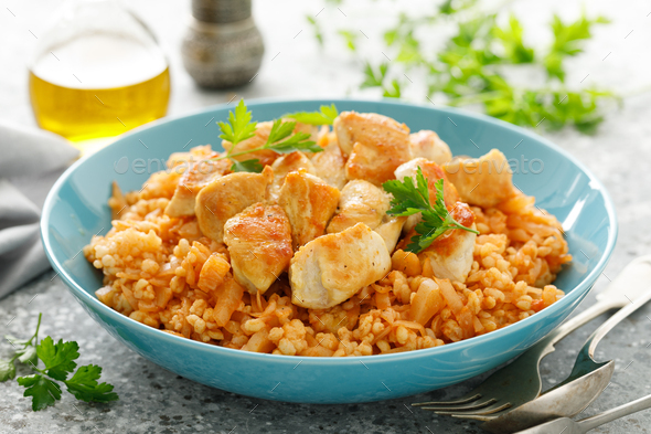 Fried cabbage, bulgur and chicken breast - Stock Photo - Images