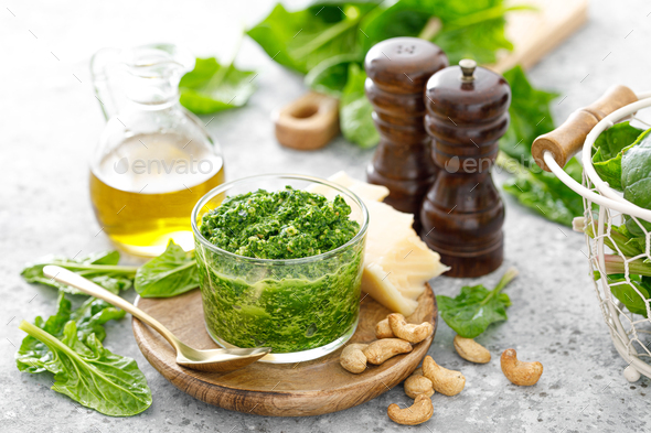 Spinach pesto sauce with cashew, parmesan cheese and olive oil - Stock Photo - Images