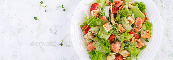 Caesar Salad with Salmon. Fish menu. Seafood - salmon. Top view, overhead, banner - Stock Photo - Images