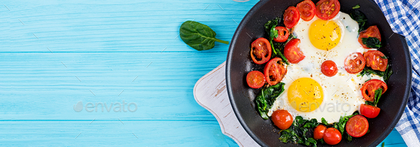 Ketogenic diet food. Fried egg, spinach, and tomatoes. - Stock Photo - Images