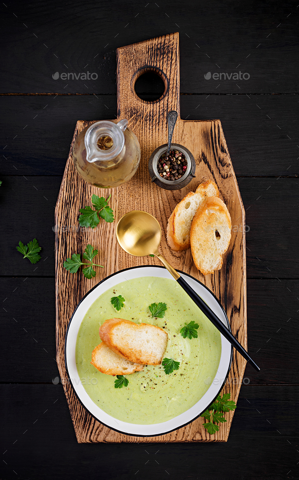 Homemade broccoli cream soup with croutons in white bowl - Stock Photo - Images
