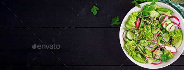 Vegetarian vegetable salad of radish, cucumbers, lettuce - Stock Photo - Images