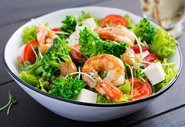 Delicious fresh salad with shrimps / prawns, broccoli, feta cheese, tomatoes - Stock Photo - Images