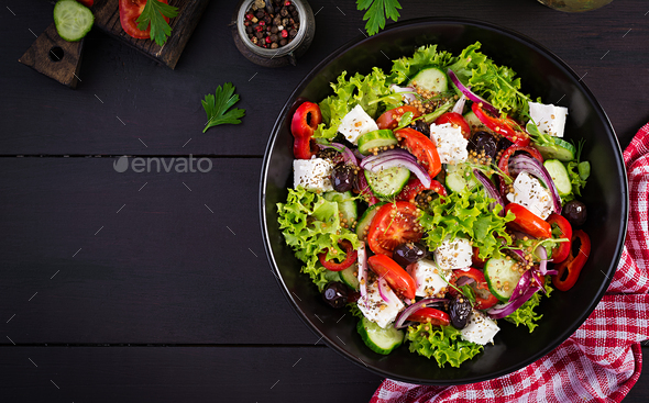 Greek salad with cucumber, tomato, sweet pepper, lettuce, red onion, feta cheese - Stock Photo - Images