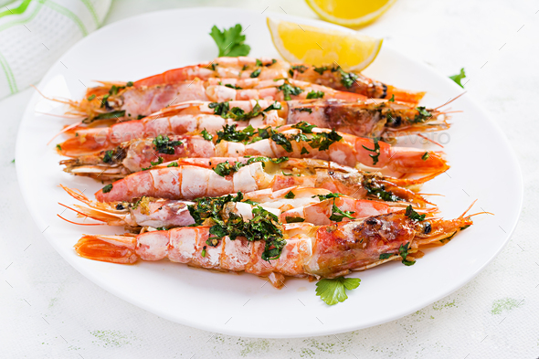Grilled wild Argentinian red shrimps/prawns with parsley, oil, garlic and lemon. - Stock Photo - Images