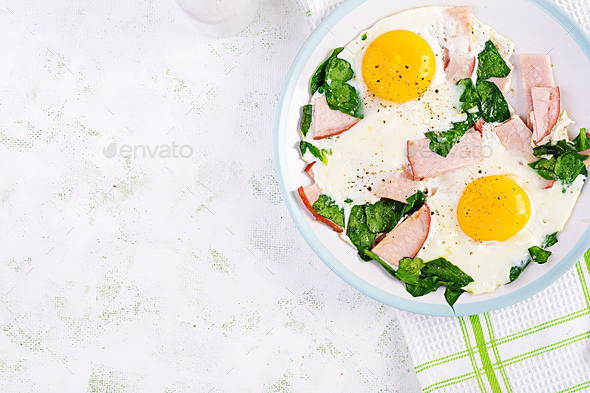 Fried eggs  with ham and spinach. - Stock Photo - Images