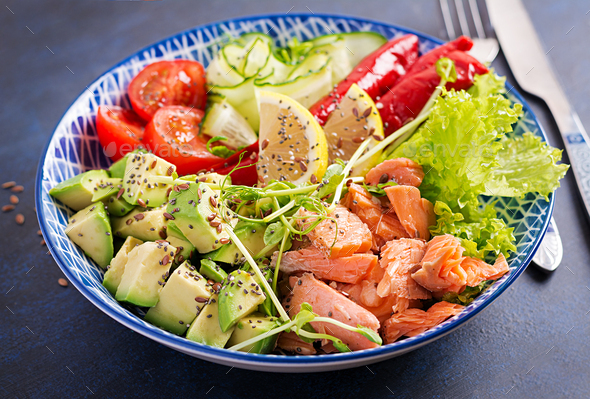 Healthy grilled salmon, avocado, tomato, cucumber, paprika and chia seeds - Stock Photo - Images