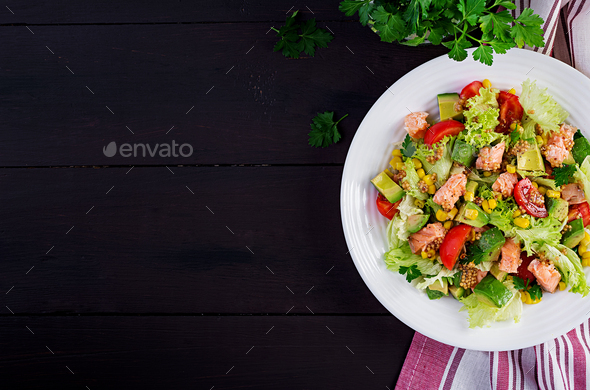 Salad with grilled salmon, lettuce, avocado, tomatoes and corn - Stock Photo - Images