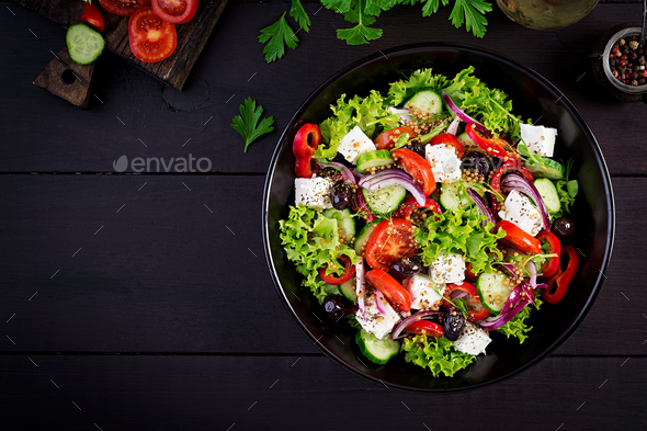 Healthy food. Greek salad with cucumber, tomato, sweet pepper, lettuce, red onion - Stock Photo - Images