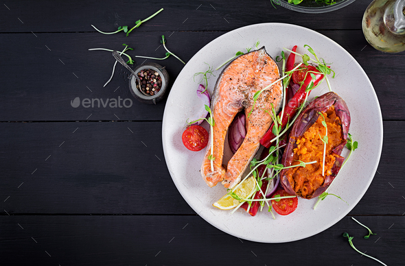 Healthy food: baked salmon and sweet potato and vegetables - Stock Photo - Images