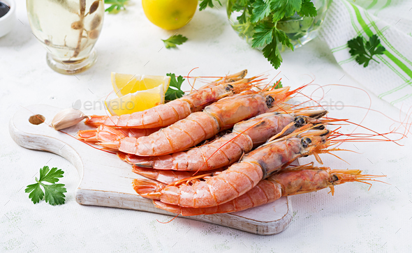 Raw wild Argentinian red shrimps/prawns  and ingredients for cooking. - Stock Photo - Images