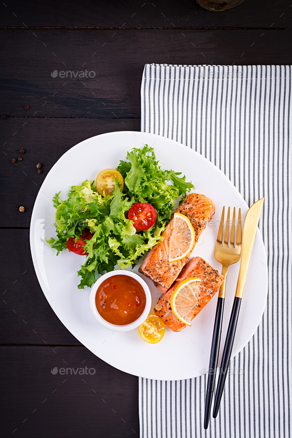 Baked salmon fillet with fresh vegetables salad. Healthy food. Ketogenic/paleo diet. - Stock Photo - Images