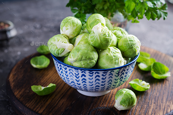 Fresh organic brussels sprouts in a bowl on a dark background. Healthy food. Vegan/vegetarian meal. - Stock Photo - Images