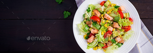Salad with grilled salmon, lettuce, avocado, tomatoes and corn on a white bowl. - Stock Photo - Images