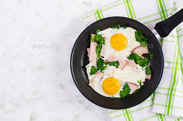 Fried eggs  with ham and spinach. Delicious English Breakfast. Brunch. - Stock Photo - Images