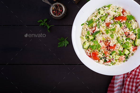 Traditional Lebanese Salad Tabbouleh. Couscous with parsley, tomato, cucumber - Stock Photo - Images