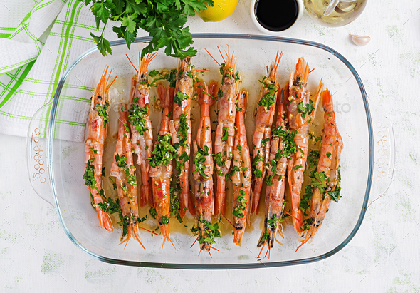 Grilled wild Argentinian red shrimps/prawns with parsley - Stock Photo - Images