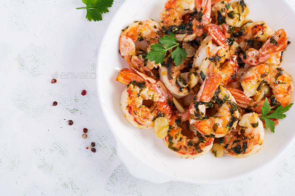 Grilled shrimps. King prawn tails in orange-garlic sauce with parsley. Top view, copy space - Stock Photo - Images