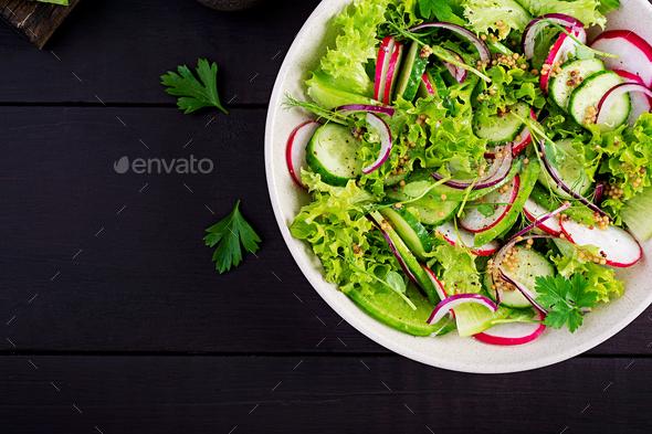 Healthy vegan food. Vegetarian vegetable salad of radish, cucumbers, lettuce - Stock Photo - Images