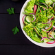 Healthy vegan food. Vegetarian vegetable salad of radish, cucumbers, lettuce - PhotoDune Item for Sale
