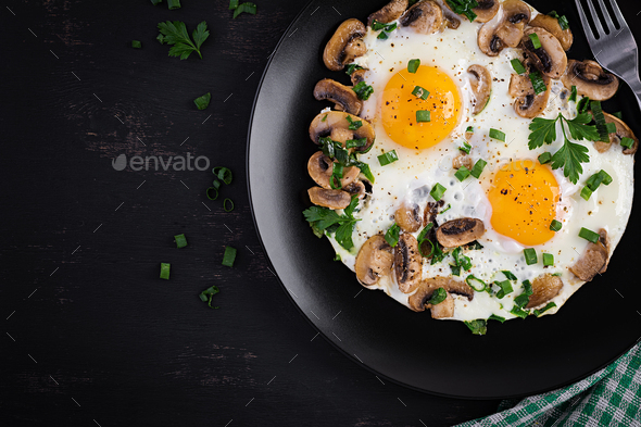 Fried egg, mushrooms and spinach. Keto, paleo breakfast. Top view, copy space - Stock Photo - Images