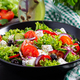 Healthy food. Greek salad with cucumber, tomato, sweet pepper, lettuce, red onion, feta cheese - PhotoDune Item for Sale