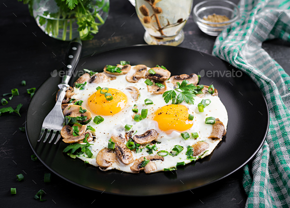 Fried egg, mushrooms and spinach. Keto, paleo breakfast. - Stock Photo - Images