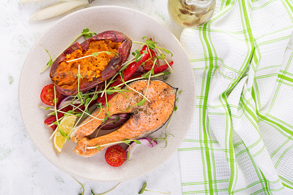 Healthy food: baked salmon and sweet potato and vegetables. - Stock Photo - Images