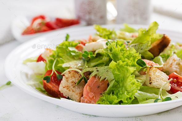 Caesar Salad with Salmon. Fish menu. Seafood - salmon. - Stock Photo - Images