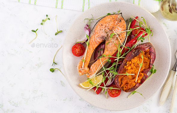 Healthy food: baked salmon and sweet potato and vegetables. Top view , overhead - Stock Photo - Images