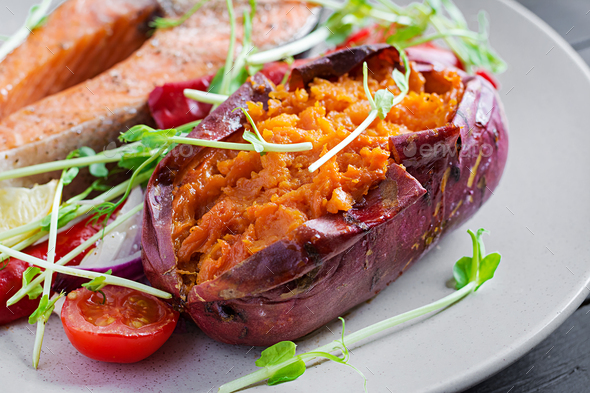 Baked sweet potatoes with butter. Vegetarian cuisine. Diet menu. - Stock Photo - Images