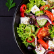 Healthy food. Greek salad with cucumber, tomato, sweet pepper, lettuce, red onion, feta - PhotoDune Item for Sale