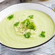 Homemade broccoli cream soup with croutons in white bowl on grey background. - PhotoDune Item for Sale
