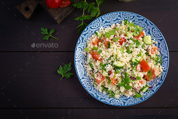 Traditional Lebanese Salad Tabbouleh. Couscous with parsley, tomato, cucumber, lemon - Stock Photo - Images
